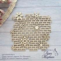 Фон снежинки на кирпичной стене